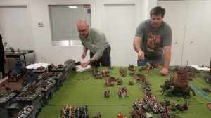 Rolling for the Empire artillery. The dice were with me for once, and I was able to take out both the giant and the Squiggoth before they reached the walls.