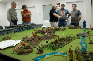 Phil and me at the left. At the right, Richard Hale, the mastermind behind this massive battle, talks to event organizer Blake Shrode and miniature painting guest of honor Dave Taylor.
